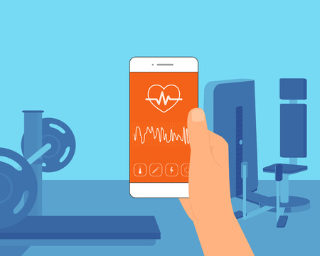 gym equipment: Man training in the gym and getting information of his pulse rate using mobile app for sport