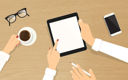 colleague: Human hands hold a blank tablet pc with empty display and showing something to his colleague. Top view of realistic wooden table on the office with grasses, smartphone and coffee cup