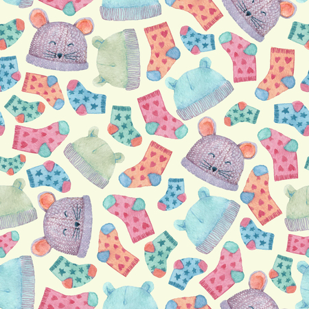 Seamless pattern with colorful hats and socks. Children clothes illustrated in watercolor.