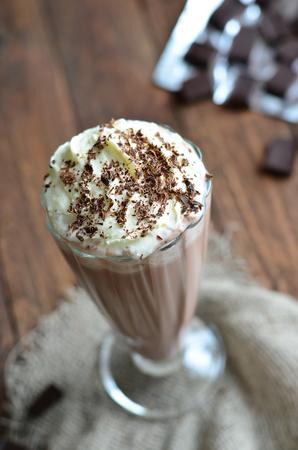 Chocolate Milkshake on wooden background, Tasty Dairy Drink