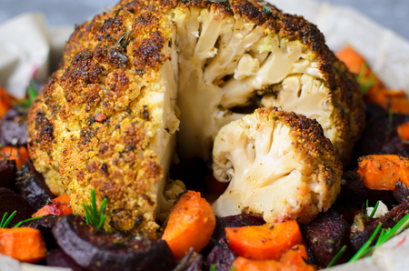 Whole Roasted Cauliflower with Vegetables, Vegan Dinner and Alternative to Roasted Chicken