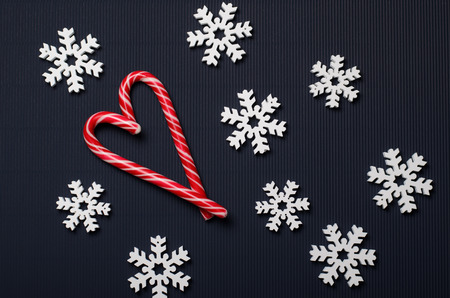 Candy Canes Heart-Shaped and Wooden Snowflakes on Blue Background, Top View, Christmas Concept, Top View, Christmas Concept