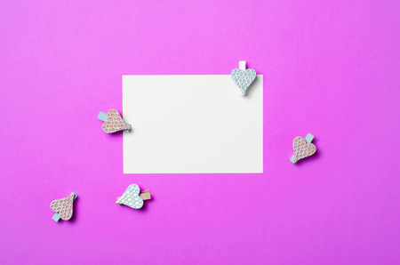 White Blank Paper on Purple Background and Heart Shaped Pins, Copy Space, Top View