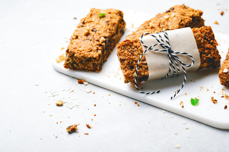 Granola Bars with Nuts and Chocolate Chips, Healthy Homemade Snack on Grey Stok Fotoğraf - 122759718