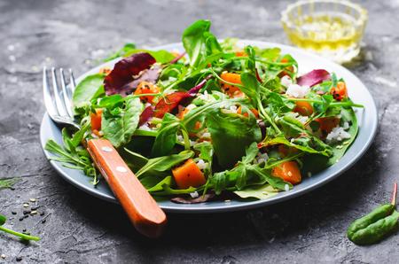Roasted Pumpkin Healthy Vegetarian Salad, Butternut Squash, Rice and Sesame Seeds Salad over Dark Background