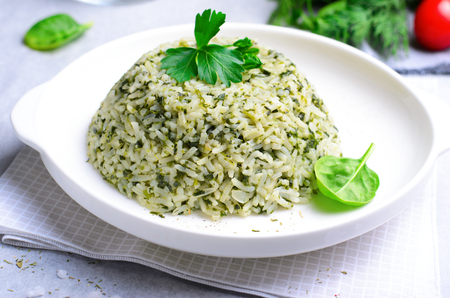 Spinach Rice on a Plate over Bright Background, Green Rice, Healthy Vegetarian Food Stok Fotoğraf
