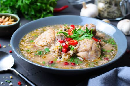 Kharcho Soup with Chicken and Herbs on Dark Background, Georgian Cuisine Stok Fotoğraf