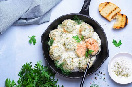 Salmon Balls with Creamy Sauce in a Skillet, Tasty Fish Balls on Bright Background Stok Fotoğraf