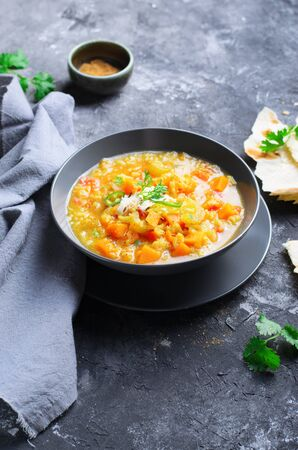 Rice and Pumpkin Indian Soup with Flat Bread on Dark Background Stok Fotoğraf