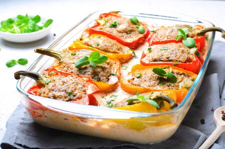 Stuffed Peppers with Meat, Vegetables and Creamy Tomato Sauce on Bright Background Stock fotó