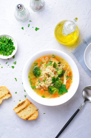 Vegetable Soup with Wild Rice and Chicken on Bright Background, Tasty Homemade Food