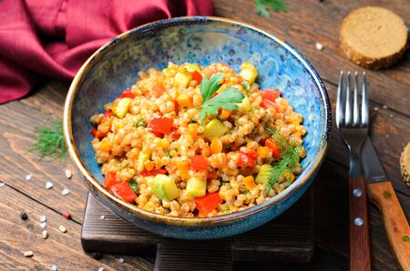 Spelt with Vegetables in a Bowl on Rustic