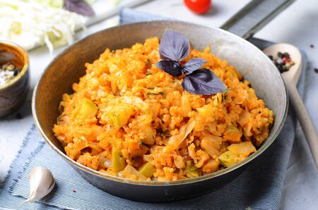 Braised Cabbage with Bulgur and Zucchini on a Pan, Tasty Vegetarian Meal Stock fotó