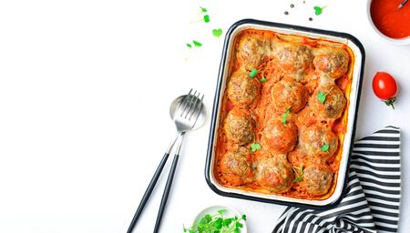 Meatballs in Tomato Sauce on a Baking Tin against White