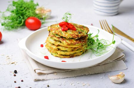 Zucchini Fritters over Bright Background, Tasty Appetizer Reklamní fotografie