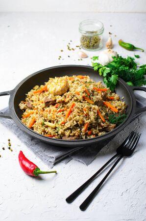 Rice and Mung Bean Pilaf with Meat and Vegetables on a Pan