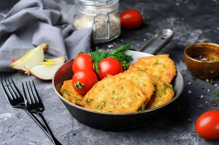 Oatmeal Fritters in a Frying Pan over Dark Background, Vegetarian Appetizer Reklamní fotografie