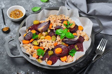 Spelt with Roasted Vegetables on a Pan over Dark Background, Vegan Meal