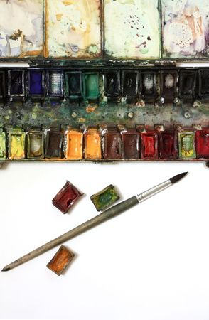 paintbox: well-used paintbox and brushes in over white background Stock Photo