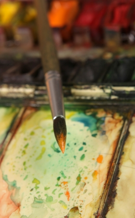 paintbox: well-used brush and paintbox Stock Photo