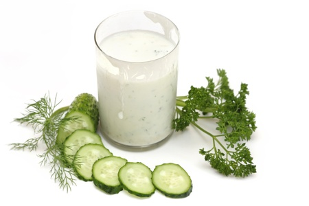 kefir: kefir with cucumber, parsley and fennel isolated on white