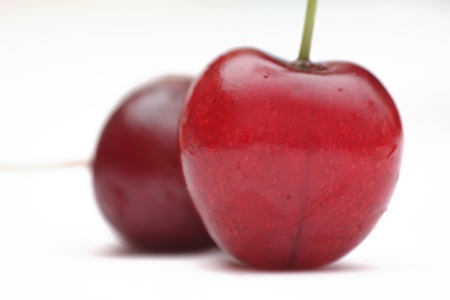 bacca: two mazzard cherries in over white background
