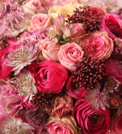 rose bush: close-up of wedding bouquet with Astrantia, Skimma, Brassica, rose bush, Ranunculus asiaticus, cloves,