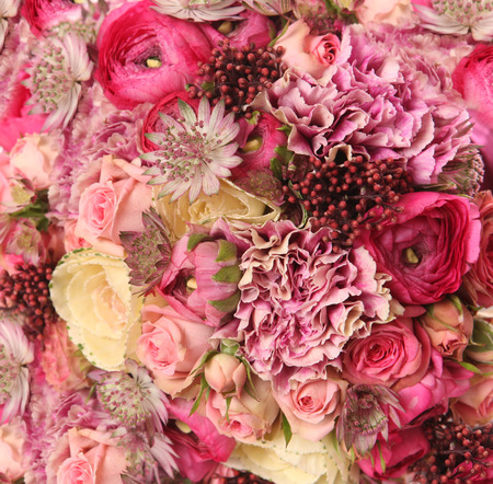 rose petals: close-up of wedding bouquet with Astrantia, Skimma, Brassica, rose bush, Ranunculus asiaticus, cloves,