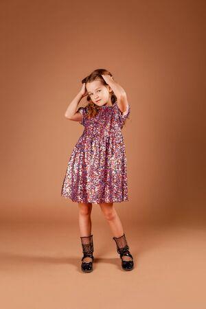 girl in a pink sequin dress Zdjęcie Seryjne