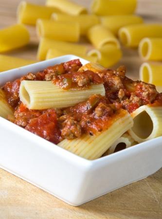 rigatoni tube pasta with bolognaise sauce Фото со стока