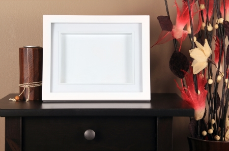 night table:  picture frame on table  Stock Photo