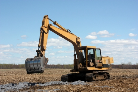 cultivated land:  excavator on cultivated land