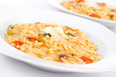Tomato and basil orzo Imagens