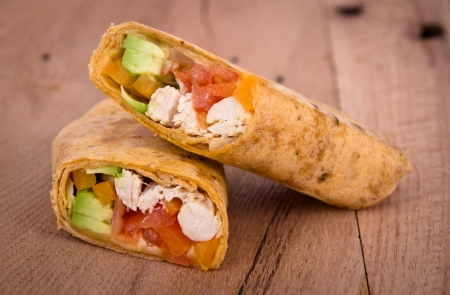 chicken avocado wrap sandwich on table photo
