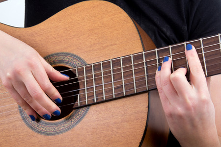 fingers: woman fingers playing guitar