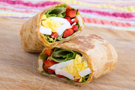 boiled eggs: Egg cheese and pepper sandwich wrap Stock Photo
