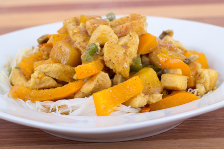 chicken and mango curry on rice noodle