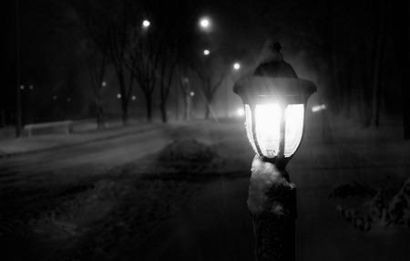 snowy blizzard night streetlight lantern