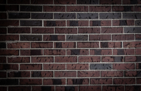 Old dark brick wall background Stock Photo