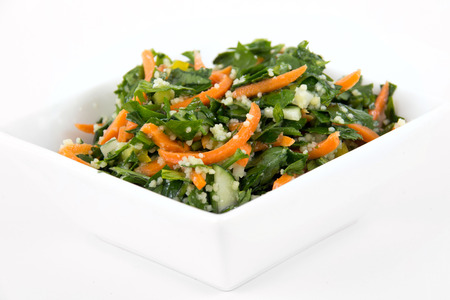 tabbouleh: tabbouleh parsley and carrot salad bowl over white background