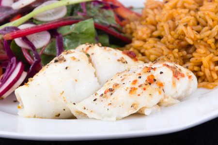 sole: baked sole fish roll with rice and fresh salad dish Stock Photo