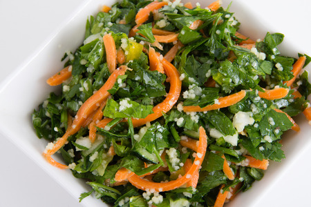 tabbouleh: tabbouleh parsley and carrot salad bowl white background
