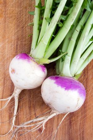 two organic purple top turnip on table