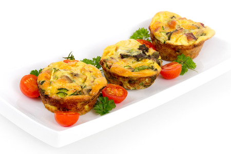 white eggs: egg muffin cup dinner quiche and omelet style with mushroom and pepper Stock Photo