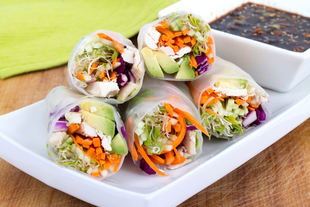 colourful chicken, sprouts and avocado rice paper spring rolls with soy base dip sauce