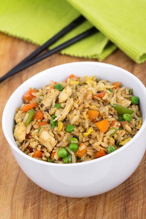 egg fried chicken rice bowl on table with chopstick