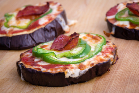 pizza crust: pizza on grilled eggplant slices as pizza crust on table Stock Photo