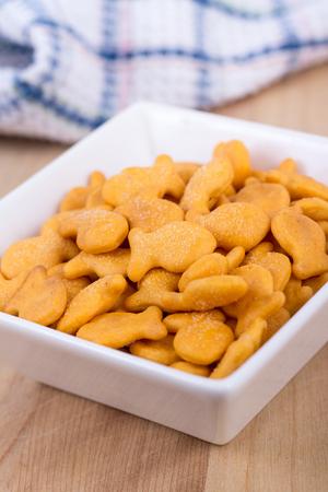 shaped: fish shaped cheddar crackers bowl Stock Photo