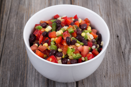 low carb diet: fresh mexican bean salad bowl on the table