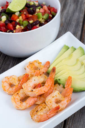 low carb diet: Shrimp avocado and mexican bean salad dish on table Stock Photo